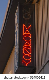 Close up of a red, lit up, neon No Vacancy sign showing there is a vacancy