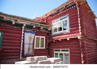 Close up of  red log cabins at The Serta Larung Five Science Buddhist Academy (Chinese: Seda Larong Wuming Buddhist  Academy) in Sertar county, Garze Tibetan Autonomous Prefecture, Sichuan, China.