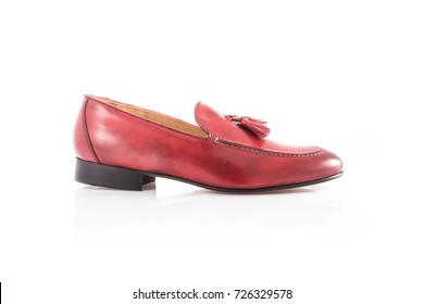 Close up of a red mens loafers on white background with reflection. Fashion advertising shoes photos.