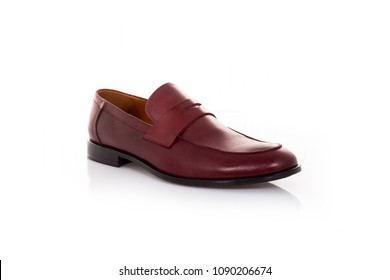 Close up of a red mens penny loafers on white background with reflection. Fashion advertising shoes photos.