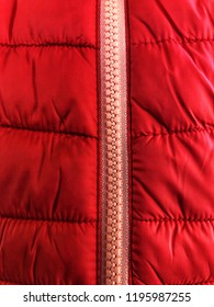 Close up of red puffer jacket and zip