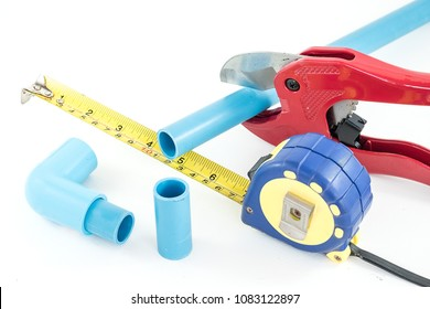 Close up red pvc pipe Cutting Pliers and 90 degree pvc(Polyvinyl chloride) connector  and pvc(Polyvinyl chloride) pipe for Plumbing repair in home Every pieces on isolated white background