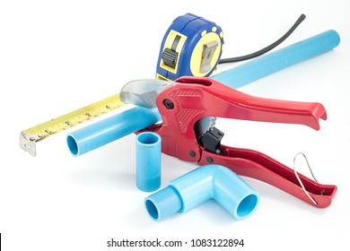 Close up red pvc(Polyvinyl chloride) pipe Cutting Pliers and 90 degree pvc(Polyvinyl chloride) connector  and pvc pipe for Plumbing repair in home Every pieces on isolated white background