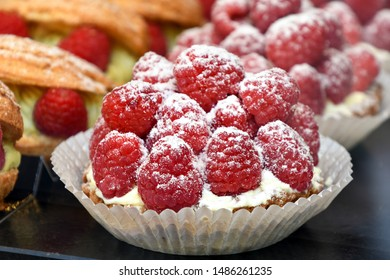 close up of red raspberry tart in bakery