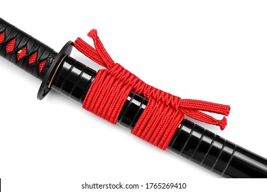 Close up red Sageo : cord for tie the shiny black scabbard of Japanese sword isolated in white background