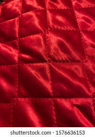 Close up of red silk fabric with square pattern