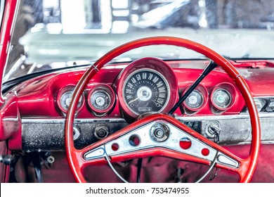 close up to red steering wheel, Vintage car with effect filter, retro background.