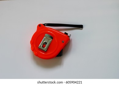 Close up the red tape measure on white background
