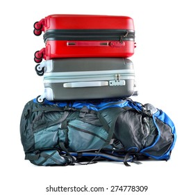 Close up of red travel luggage and big backpack isolated on white background, selective focus.