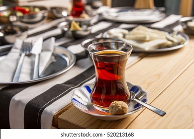 Close Up Red Turkish tea with traditional glass, focus blur