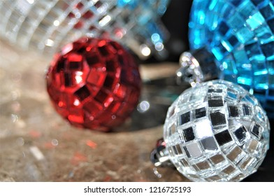 Close up of red white and blue Christmas tree ornaments.