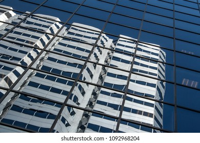 Close up of Reflection Buildings on blue glass