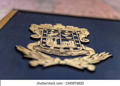 Close up to the relief of the beautiful coat of arms of the state of Michoacan made of a golden metal plate