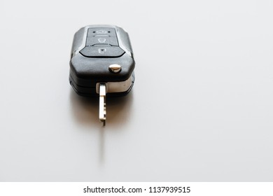 Close up of Remote electronic car key with mechanical second opening on white background.