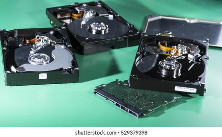 Close up of a repair of a hard disk with laboratory instruments