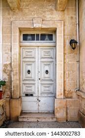 close up retro style old house door of Mediterranean architectural culture in Mediterranean island Malta
