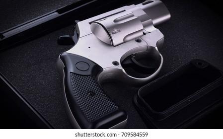 Close up revolver in a case