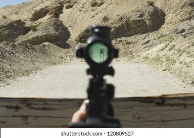 Close up of rifle scoop aiming target