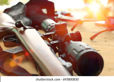 close up of rifle telescope for sport hunting on table wooden