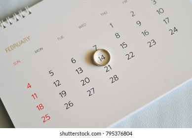 Close up ring marking on white calendar in Vlentine's Day concept.