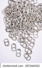 Close up rings pull aluminum of soda or beer can isolate on white background.