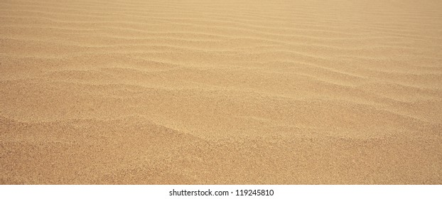close up rippled sand as the background