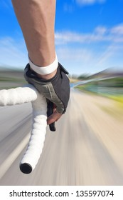 Close up of road bike rider with motion blurred roadway