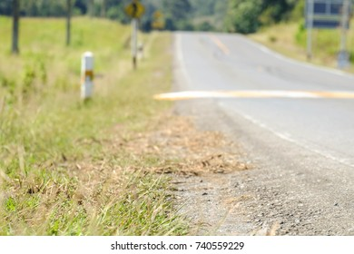 Close up road and blurred sign background