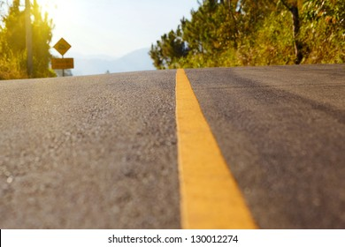 Close up road divide yellow line