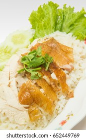 Close up of roasted chicken with rice and vegetable