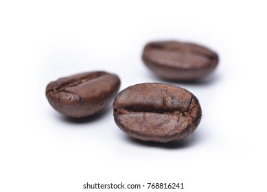 Close up roasted coffee beans isolated on white background, selective focus