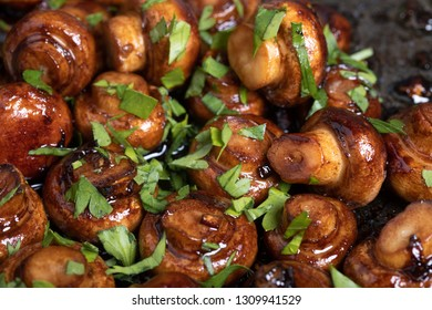 Close up of roasted mushrooms with garlic and parsley
