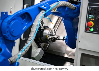 Close up robot hands in milling /drilling metalworking process,mechanical turning metal working ,metal work Industrial ,CNC metal machining ,hand tool machine,industrial robots