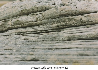 Close up of rocks on lake shore