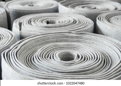 Close up roll of car insulation polyester fiber or felt background