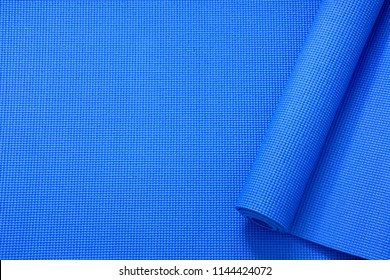 close up rolled blue color yoga mat texture background,top view, copy space, healthy lifestyle, sport and  exercise concept