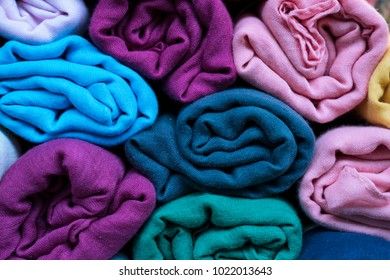 close up of rolled colorful clothes