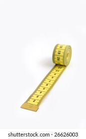 Close up of rolled tape measurement on white background