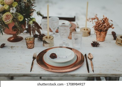 Close up of romantic wedding table in the middle of the mountain. Winter wedding decor.