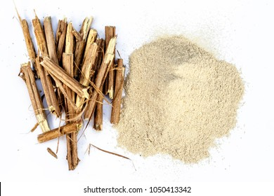 Close up of the roots of Ashwagandha roots and its powder also known as Indian ginseng, isolated on white essential beneficial for hair loss, gives strength,increase testosterone,good for your thyroid