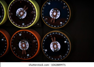 Close up of rotating dials on the front of the British military's rebuilt Bombe machine at Bletchley Park designed to decrypt messages encoded by the German Enigma machine during world war 2