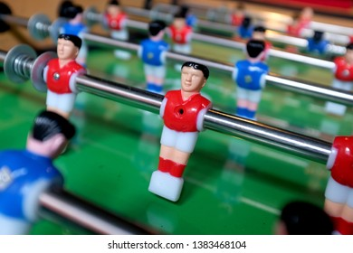Close up of rotating miniature figures of a table football or foosball