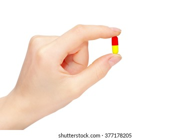 close up round white pill in hand