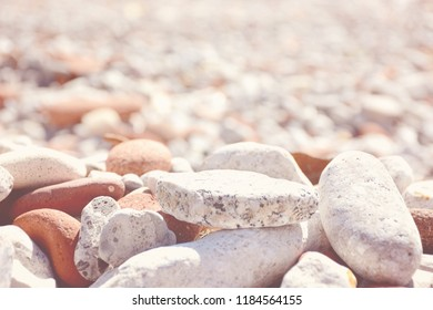 Close up of rounded and polished beach rocks made of recycled bricks at Leslie Street Spit, Tommy Thompson Park.