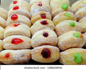 close up row of colorful donut such as red,purple and green on cand tray.shoot on supermarket
