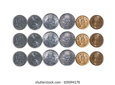 Close up of  a row of Indian currency Coins, 5 rupees, 2 rupees, 1 rupee, isolated on white background, extra copy space,