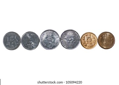 Close up of  a row of Indian currency Coins, 5 rupees, 2 rupees, 1 rupee, isolated on white background, copy space,
