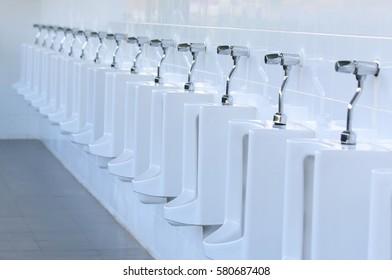 Close up row of outdoor urinals men public toilet.