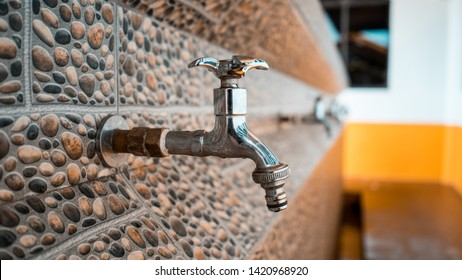 A close up of a row of water taps of a beautifully decorated muslim ablution area