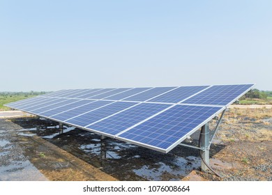 Close up rows array of polycrystalline silicon solar cells or photovoltaics in solar power plant turn up skyward absorb the sunlight from the sun use light energy to generate electricity